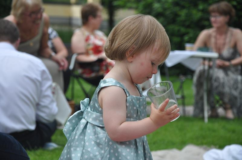 Our daughter Ellen exploring a glas of water.